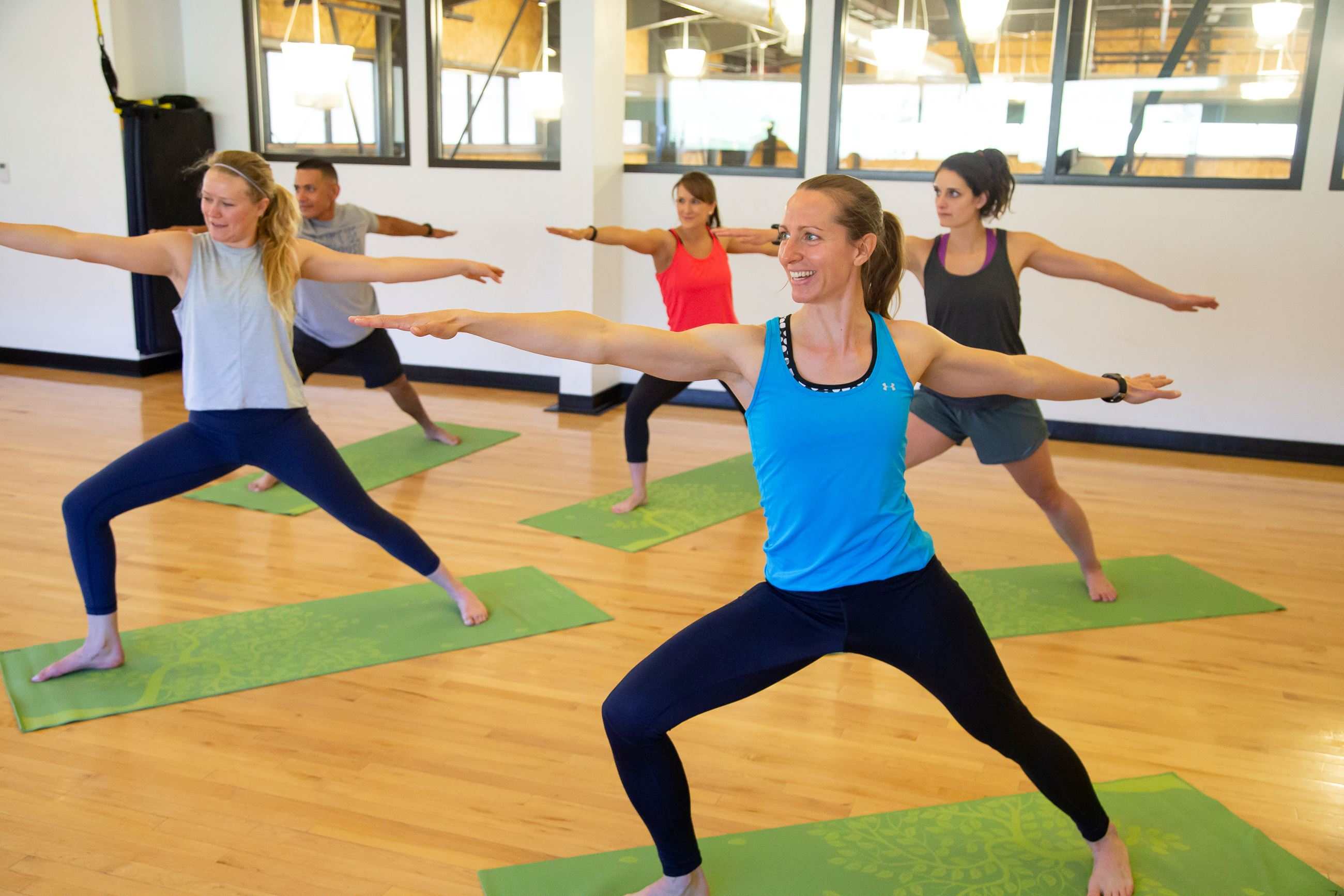 Group Practicing Warrior Pose in Yoga Class